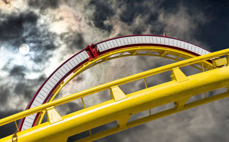 Abstract picture of the cut out part of a roller coaster in front of a dramatic sky, Hannover Banco de Imagens