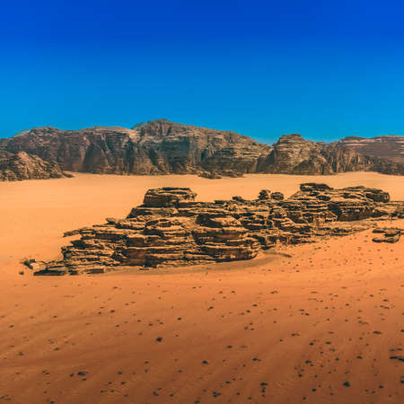 Red sand and rocks under a cloedless deep blue sky in the desert of Wadi Rum, Jordan, Middle east