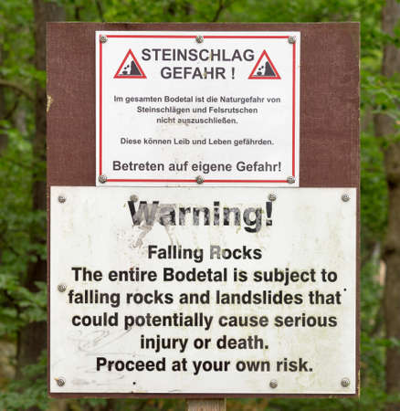 Warning sign of falling rocks and landslides at the entrance of the Bodetal near Thale, Harz. (German text identical to English text) Editorial