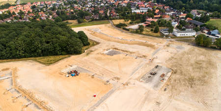 Aerial photos of the building site for the development of a new development area, which is en adjacent to the development of an old village centre. Banco de Imagens