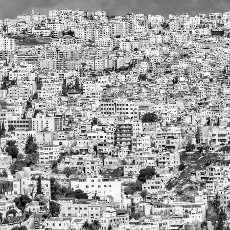 Black and white section of a view of Amman, the ugly overcrowded capital of Jordan.