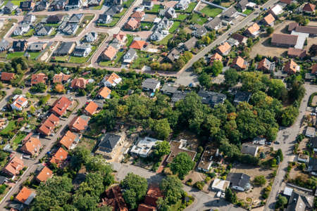 Aerial photograph of a German suburb with detached houses and a shopping center