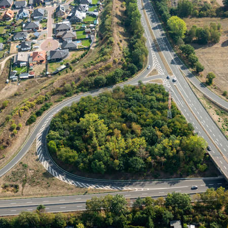 Aerial view of the access road and crossing of a federal highway with a country road in Germany.