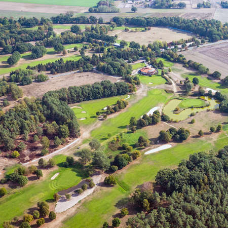 Aerial view of a golf course in the North German heath landscape.