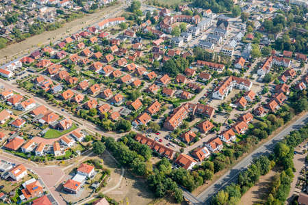 Aerial view of a German suburb with streets and many small houses for families, photographed by a gyrocopter.