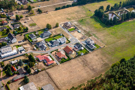 Aerial view of the edge of a German village, which is growing by the designation of new building areas for single-family houses