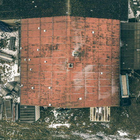 Abstract view from a vertical perspective of an old ugly annex on a shed, taken with the drone from the air.