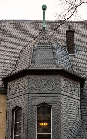 Completely covered with black slate from small slate slabs past the old district court in the old town of the Harz city
