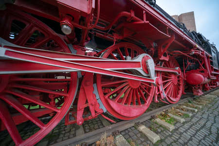Close-up of the heavy iron wheels of a historic locomotive