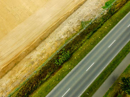 Graphic and abstract aerial view of the vertical photograph of a road with markings between fields, Germany 版權商用圖片