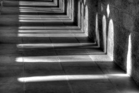 Light and shadow in the cloister in the Kaiserdom of Königslutter am Elm in bright sunshine ..