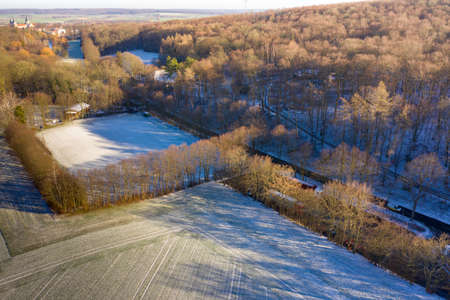 Aerial view of a football field of a district league team in a village with the first snow of the year, drone shot 版權商用圖片