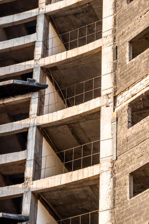 Detail of a skyscraper burnt down during construction in the center of an African metropolis.