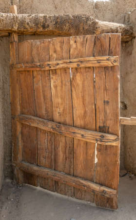 Rustic gate made of untreated wood with characteristic grain