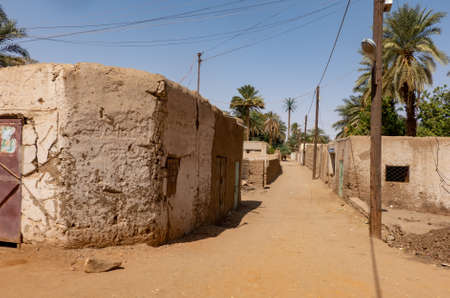 Lonely empty unpaved road in a village in the desert of Sudan