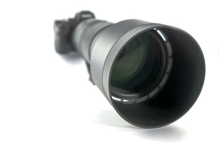 Mirrorless system camera with ultratele telezoom 150mm to 600mm with focus on the front part of the sun visor