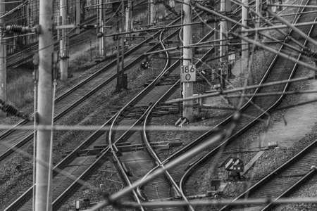 Switches, track systems and overhead lines of a railway line in Germany, monochrome 版權商用圖片
