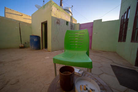 Inner courtyard in a Nubian guest house in Sudan with a view of the wash house in front of the breakfast table with coffee and cigarettes, Africa 版權商用圖片