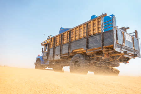 Water wagons and water barrels in the middle of the desert of Sudan