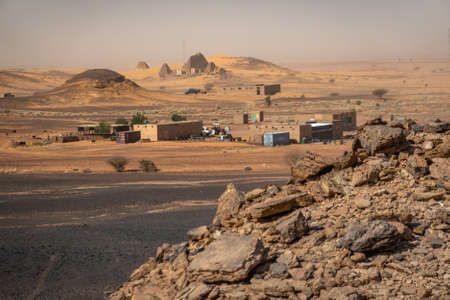 View from the scree desert over a desert camp to the pyramids of Meroe