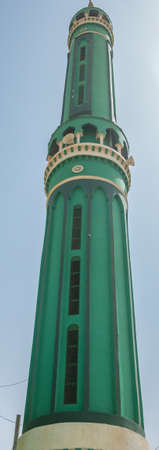 Green or turquoise minaret of an Islamic mosque, Sudan
