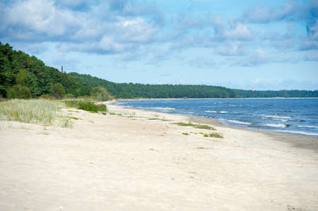 jurmala: Baltic Sea Coastline-Seaside near Jurmala, Latvia. The Baltic Sea is a sea of the Atlantic Ocean, enclosed by Scandinavia, Finland, the Baltic countries, and the North European Plain. Stock Photo
