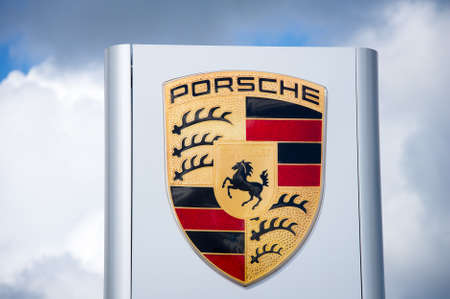 ag: VILNIUS - AUG 7: Porsche dealership logo on Aug. 7, 2016 in Vilnius, Lithuania. Porsche AG is a German automobile manufacturer specializing in high-performance sports cars, supercars, hypercars, SUVs. Editorial