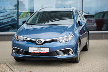 touring: VILNIUS, LITHUANIA - AUGUST 7, 2016: Brand new Toyota Auris Touring Sports car. The Toyota Auris is a compact hatchback derived from the Toyota Corolla. The station wagon called the Touring Sports.