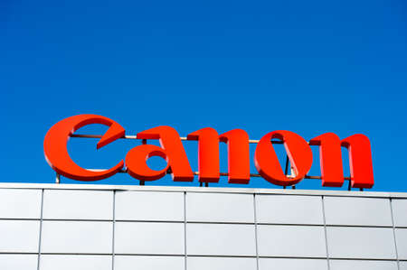 eos: VILNIUS, LITHUANIA - AUGUST 7, 2016:Canon logo. Canon Inc. is a Japanese multinational corporation specialized in the manufacture of imaging and optical products, including cameras.