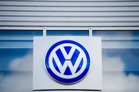 automaker: VILNIUS, LITHUANIA - AUGUST 7, 2016: VW dealership logo. Volkswagen is a German automobile manufacturer and the biggest German automaker and the second largest automaker in the world in 2016. Editorial