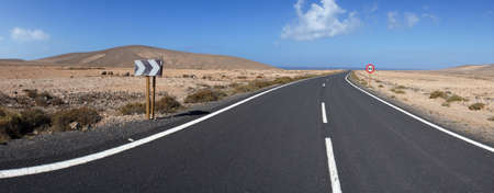 The road through rocky and volcanic desert  Near Los Molinos, Fuerteventura, Canary Islands  photo