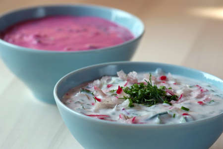 polish lithuanian: Chłodnik - cold beetroot soup in a bowl on a wooden table  Seasonal dish
