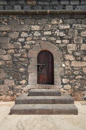 wood carving door: Old wooden Renaissance castle doors from Castillo de San Gabriel Stock Photo