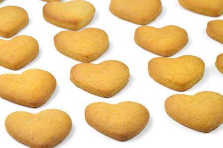 Homemade cookies (heart shape) in a rows Stock Photo - 17246613