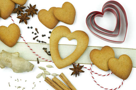 Composition of heart shape cookies and spices. photo