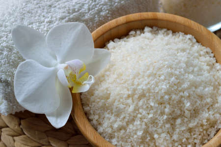 Close up of spa set with salt bath. Thermal spring bath salt with essential oil. photo
