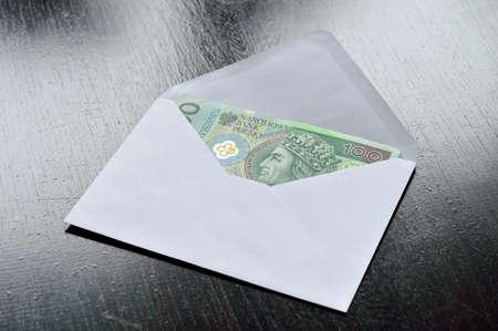 Polish money in envelope – bribe. Poland. Stock Photo