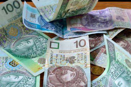 Polish money - PLN, zloty. Few different polish banknotes lying on the table. Stock Photo