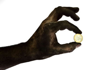 Dirty hand holding one euro coin. Isolated on white photo