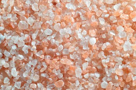 Pink salt from the Himalaya - background  Closeup of salt crystals