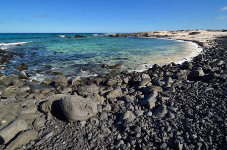 blanco: Stone beach on Canary Islands, Lanzarote. Spain. Caleta del Mojon Blanco.