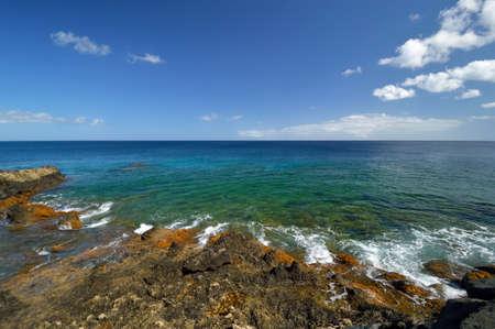 Low tide at the Atlantic Ocean rocky coast. Charco del Palo, Lanzarote, Canary Islands, Spain.