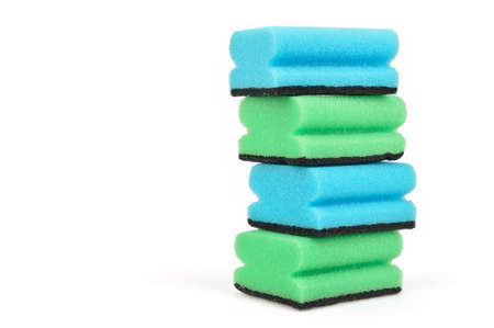 Stack of dish washing sponges  Green and blue sponges isolated on white  photo