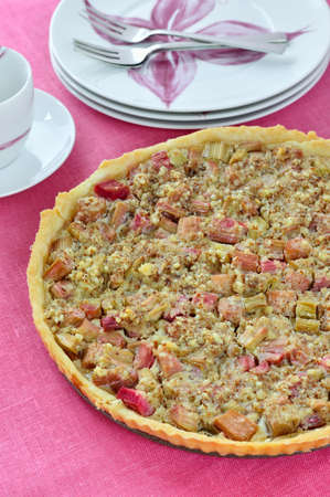 short crust pastry: Rhubarb   almond tart on pink table  Short crust pastry with rhubarb and almond  Stock Photo