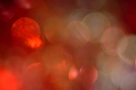 Blurred, bokeh lights background  Abstract red sparkles  photo