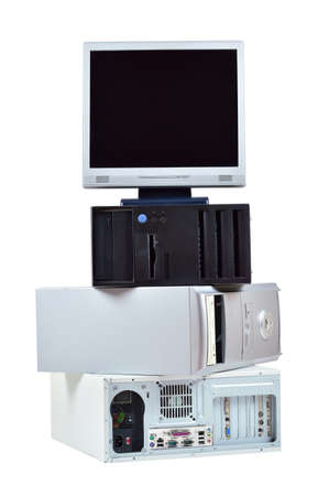 old technology: Old computer and electronic waste  Stack of old pc computers and monitor isolated on white background