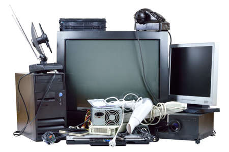 Old and used electric home waste Obsolete pc computer, telephone, CRT monitor, DVD