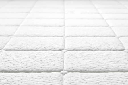 Close-up of white mattress texture  Patter of quilted material  Comfortable mattress  Copy space  photo