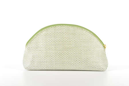 One green and white cosmetic bag without any cosmetics isolated on white background  Stock Photo