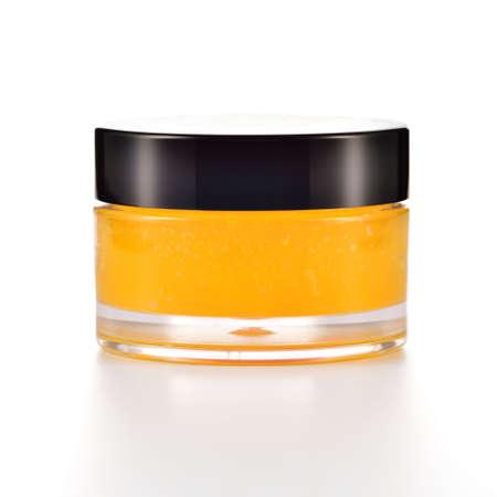 Orangenzucker Lippe scheuern auf weißem Hintergrund Orange kosmetische im Glas Standard-Bild - 24208030